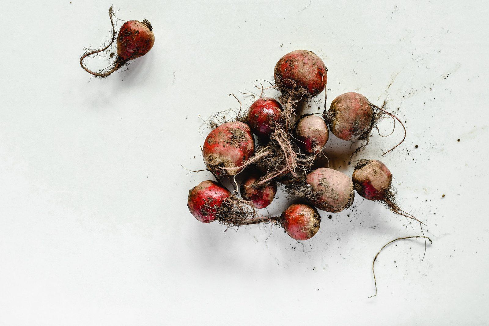 canva-red-round-fruits-on-white-surface-MAEMVOne0QE
